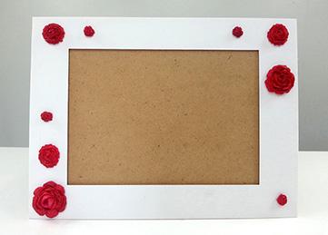 Cadre photo décoré avec des fleurs en pate fimo maison